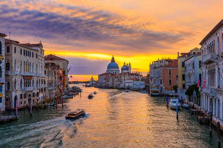 Grand Canal with Basilica di Santa Maria della Salute in Venice, Italy. Sunrise view of Venice Grand Canal. Architecture and landmarks of Venice. Venice postcard Reklamní fotografie