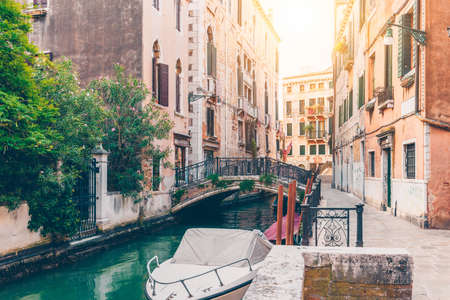 Narrow canal with bridge in Venice, Italy. Architecture and landmark of Venice. Cozy cityscape of Venice.