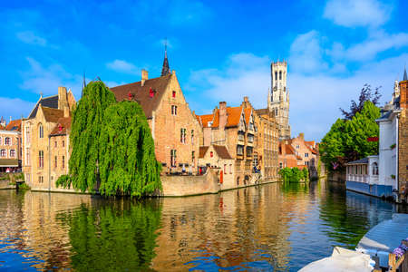 Classic view of the historic city center with canal in Brugge, West Flanders province, Belgium. Cityscape of Brugge.