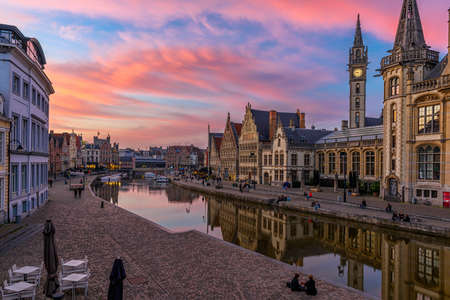 View of Graslei, Korenlei quays and Leie river in the historic city center in Ghent (Gent), Belgium. Architecture and landmark of Ghent. Sunset cityscape of Ghent. Reklamní fotografie