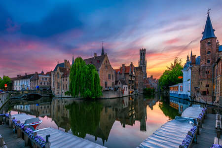 Classic view of the historic city center of Bruges (Brugge), West Flanders province, Belgium. Night city space of Bruges.