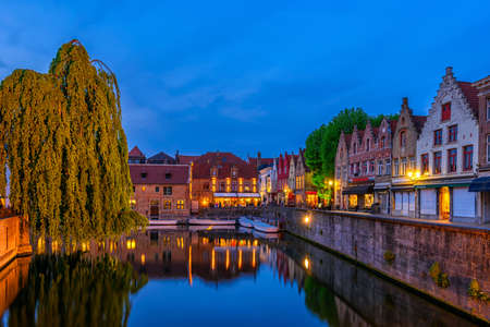Typical view of the historic city center of Bruges (Brugge), West Flanders province, Belgium. Night cityscape of Bruges.