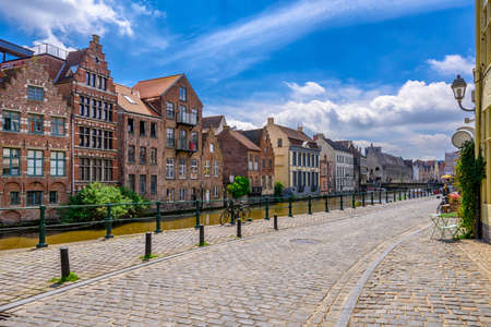 View of embankment of Leie river in the historic city center in Ghent (Gent), Belgium. Architecture and landmark of Ghent. Cityscape of Ghent.