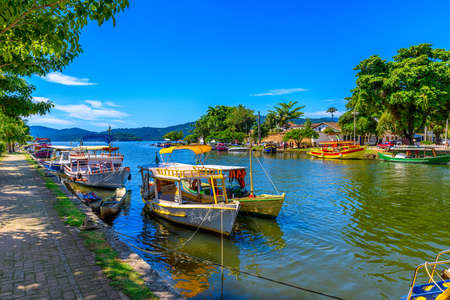 Embankment of historical center with boats in Paraty, Rio de Janeiro, Brazil. Paraty is a preserved Portuguese colonial and Brazilian Imperial municipality