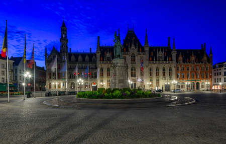 Markt (Market Square) and Provinciaal Hof (Province Court) in Bruges (Brugge), West Flanders province, Belgium. Night cityscape of Bruges.