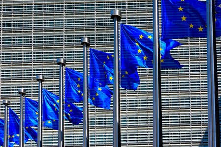 EU Flags in front of the European Union Commission building in Brussels, Belgium