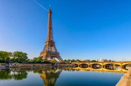 View of Eiffel Tower and river Seine at sunrise in Paris, France. Eiffel Tower is one of the most iconic landmarks of Paris Stock Photo