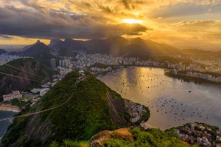 Sunset view of   Corcovado, Urca and Botafogo in Rio de Janeiro, Brazil. Sunset skyline of Rio de Janeiro