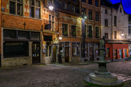 Old street in center of Brussels, Belgium. Night cityscape of Brussels (Bruxelles). Architecture and landmarks of Brussels.