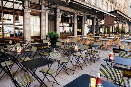 Old street with tables of cafe in center of Brussels, Belgium. Cozy cityscape of Brussels (Bruxelles). Architecture and landmarks of Brussels. 写真素材