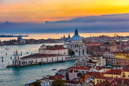 Aerial sunset view of Venice, Grand Canal and Basilica di Santa Maria della Salute in Venice, Italy. Architecture and landmarks of Venice. Venice postcard