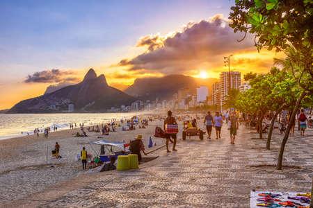 Sunset view of Ipanema beach and mountain Dois Irmao (Two Brother) in Rio de Janeiro, Brazil. Ipanema beach is the most famous beach of Rio de Janeiro, Brazil. Seascape of Rio de Janeiro.