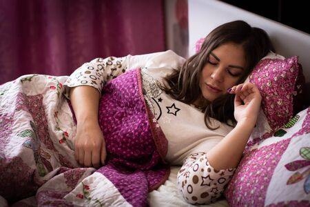 beautiful young woman sleeping in bed in the early morning. sound healthy sleep