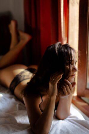 beautiful girl at her bedroom in tender feelings