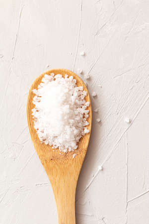 sea salt on a wooden background. Food ingredients isolated with space for text