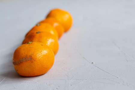 group of mandarins isolated on gray background. Ugly food trend photo with space for text
