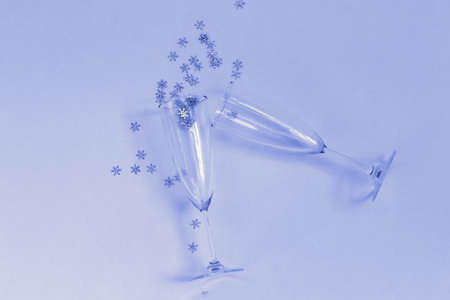 Vine glasses with a shiny snowflakes, Christmas card template, blue color tone, selective focus