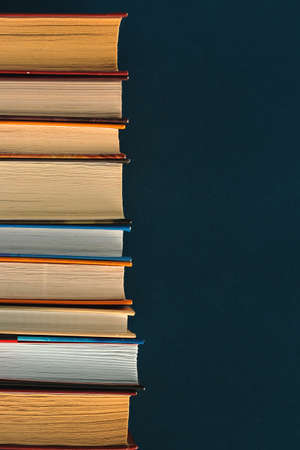 Stack of old vintage books in a library , retro tone and grain noise, vintage collection Stock Photo