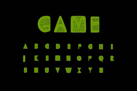 Game hand drawn vector font illustration with dots holes green on black background