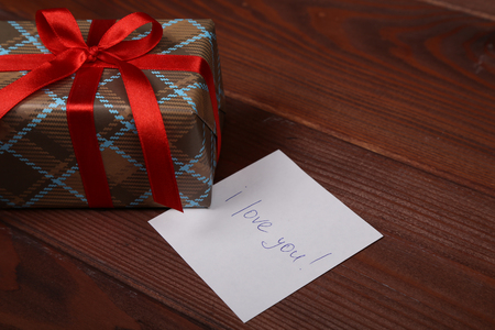 loved: beautifully wrapped holiday gift for a loved one