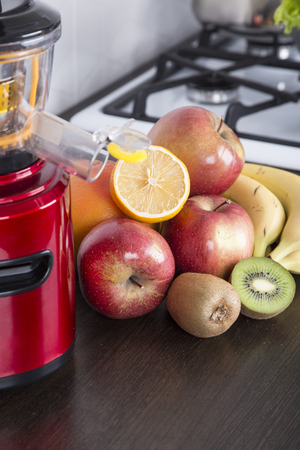 juicing fresh beautiful bright vegetables and fruits Stock Photo