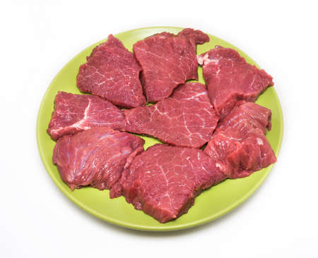 appetizing: Appetizing pieces of beef on green plate on white background.