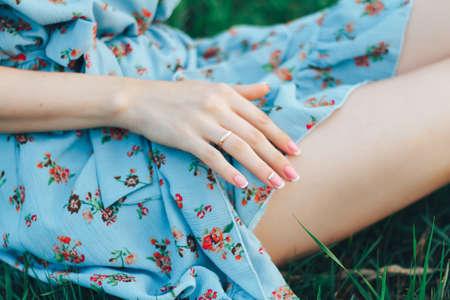 Cute girls short dress. Summer park picnik. Pretty female hand with ring. 스톡 콘텐츠
