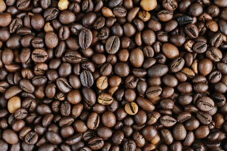 Coffee beans brown texture background.