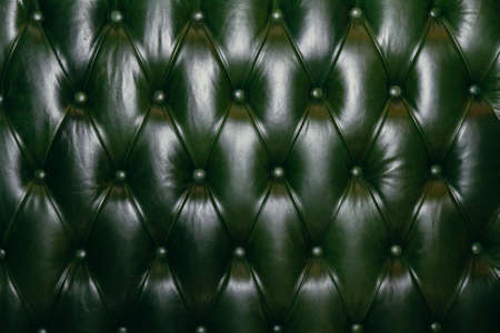 green texture of leather carriage screed upholstery fabric for furniture. 스톡 콘텐츠