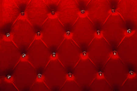 red texture of velour carriage screed upholstery fabric for furniture.