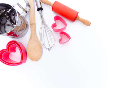 Baking background. Baking tools, whisk, spatula, rolling pin, heart molds
