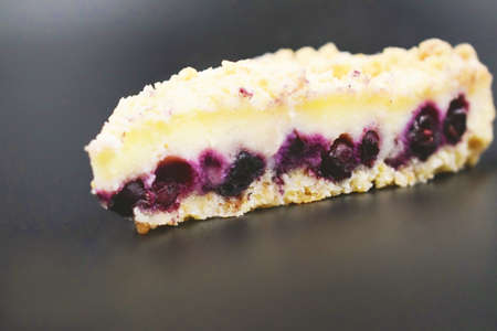 piece of pie with purple berries in a white biscuit. cutaway cake Stock Photo