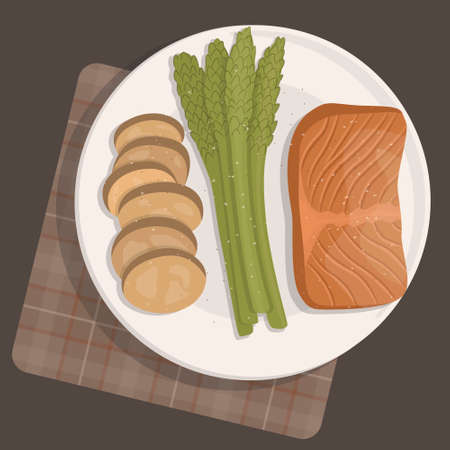 Salmon steak, baked asparagus and baked potato slices, dinner
