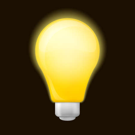 Bright yellow light bulb isolated on a black background