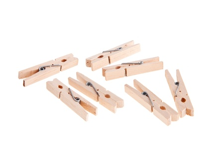Wooden clothespins on white background  photo