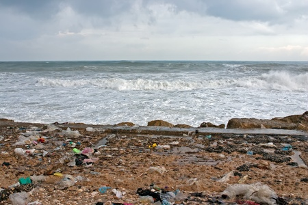 dumping: A lot of garbage on the sea coast Stock Photo