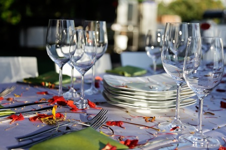 Table decorated for the wedding party covered with beautiful red flowers. Stock Photo