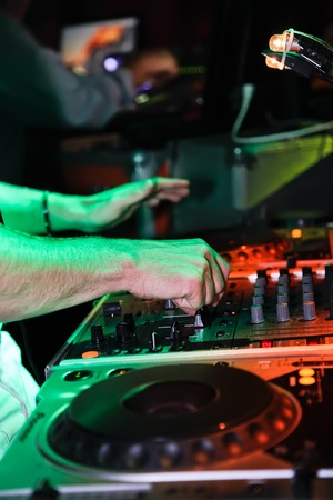 DJ mixing music at a night party.  photo