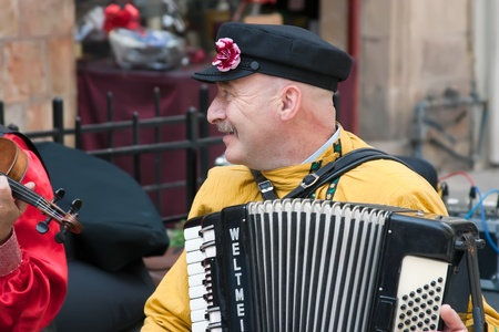 Jerusalem, Israel - 15 March 2006  Purim carnival, street musician  A man plays the accordion  In the center of Jerusalem   Purim is celebrated annually according to the Hebrew calendar on the 14th day of the Hebrew month of Adar  date 7 - 8 March 2012