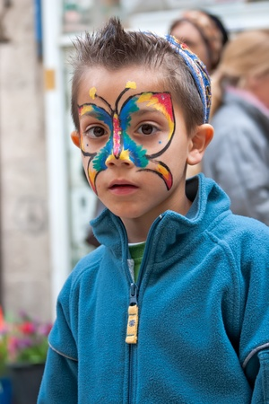 Jerusalem, Israel - 15 March 2006  Purim carnival, Little boy with a body-art on face  Portrait of a boy, his face painted butterfly  In the center of Jerusalem   Purim is celebrated annually according to the Hebrew calendar on the 14th day of the Hebrew