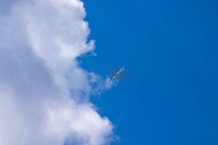 Airplane in a blue sky photo
