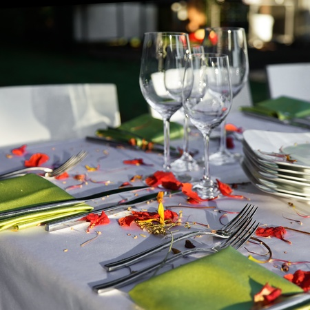 Table decorated for the wedding party covered with beautiful red flowers  photo