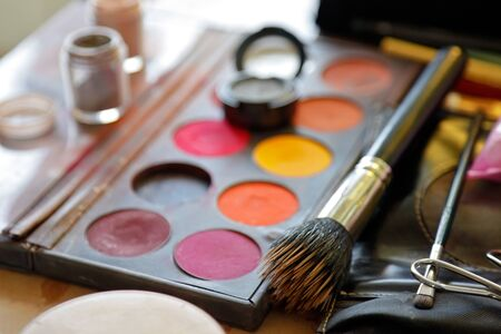 cosmetic products: Horizontal image of eye shadow and brush   Stock Photo