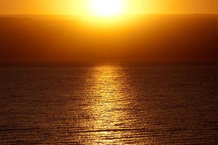 Golden sunrise over the mountains and the Dead Sea Stock Photo - 12924704