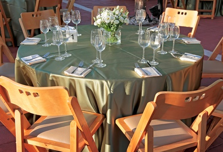table setting for a wedding or a celebratory dinner decorated with flowers  photo