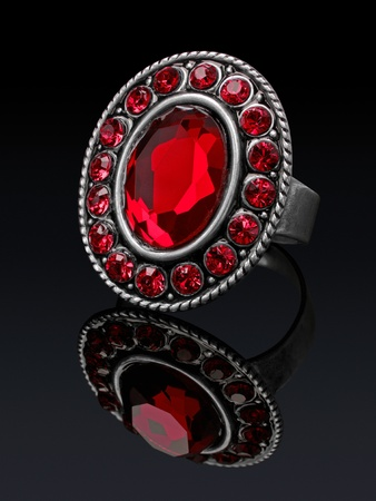 Silver ring with red stones  ruby  with reflection  photo