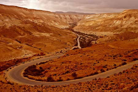 Beautiful road in the Judean red desert Stock Photo - 12990002