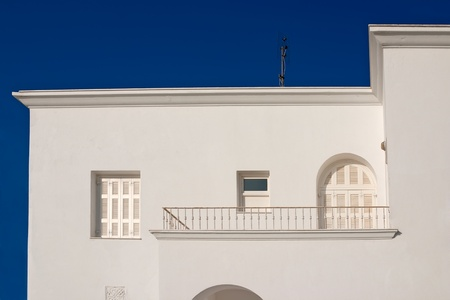 Traditional  white house with window and balcony in Santorini  photo