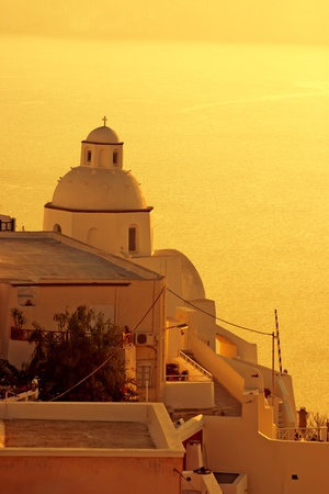 Amazing sunset at Oia village in Santorini island  photo
