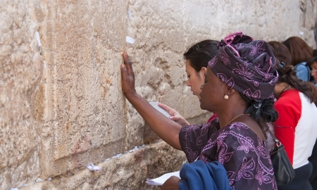 Jerusalem, Israel - March 14, 2006  Praying women at the Wailing Wall in Jerusalem  The Western Wall, Wailing Wall or Kotel is located in the Old City of Jerusalem at the foot of the western side of the Temple Mount    The Wailing Wall is the holiest plac
